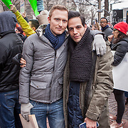 "Elliot Imse, left and Johannan Rivera attended demonstrators gathered near Trump International Hotel to protest the executive order issued by President Trump yesterday, banning refugees, migrants and foreign nationals from seven majority Muslim nations from entering the United States.  When asked aboutt heir hope for the next 4 years, Elliot, responded simply, ""Perseverance,"".  But added, ""status quo would be the best possible thing at this point...there's a real fear that LGBTQ rights will be rolled back,"" he said, reflecting on the flurry of executive activity by President Trump this week. John Boal Photography"