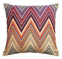 decorative multi-colored missoni pillow photographed on a white background