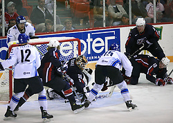 Goalkeeper Robert Esche vs Tuomo Ruutu (15) of Finland at play-off round quarterfinals ice-hockey game USA  vs Finland at IIHF WC 2008 in Halifax,  on May 14, 2008 in Metro Center, Halifax, Nova Scotia,Canada. Win of Finland 3 : 2. (Photo by Vid Ponikvar / Sportal Images)