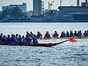 29 OCTOBER 2018 - PHRA PRADAENG, SAMUT PRAKAN, THAILAND: Long boats past the finish line after their race in Phra Pradaeng. The longboat races go about one kilometer down the Chao Phraya River to the main pier in Phra Pradaeng. The boats are crewed by about 20 oarsmen. Longboat racing traditionally marks the end of the Buddhist Rains Retreat (called Buddhist Lent) in Thai riverside communities.        PHOTO BY JACK KURTZ