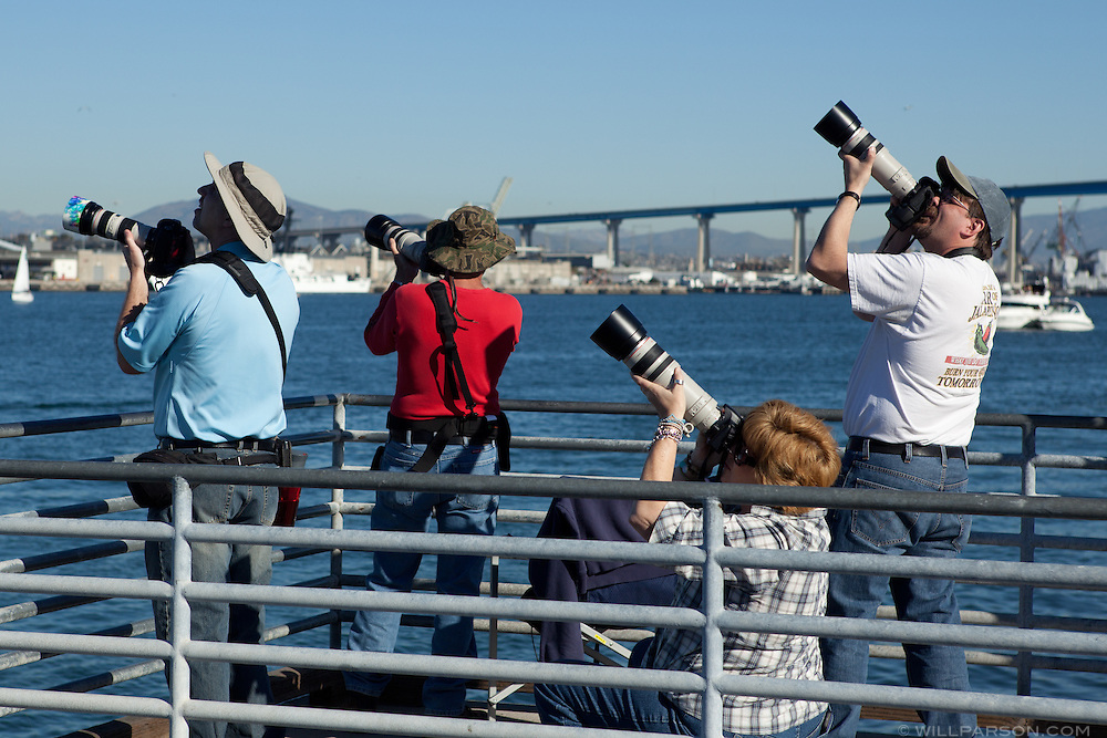 "Spectators in Coronado, CA observe the ""Parade of Flight"" during the Centennial of Naval Aviation celebration at Naval Air Station North Island, Feb. 12, 2011."