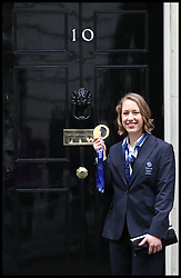 GB Olympic Team has been invited to Downing Street. Lizzy Yarnold holding her gold medal in Nº10 today. Members of the Olympic Team walk towards <br /> Nº10 for an official visit with prime minister David Cameron. 10 Downing Street, London, United Kingdom. Tuesday, 25th February 2014. Picture by Daniel Leal-Olivas / i-Images
