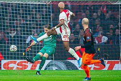 Ryan Babel #49 of Ajax and Lars Unnerstall #13 of PSV Eindhoven in action during the match between Ajax and PSV at Johan Cruyff Arena on February 02, 2020 in Amsterdam, Netherlands