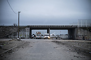 March 1, 2016 - Calais, France -<br /> <br /> Destruction Of Calais Jungle Camp Continues<br /> <br /> The entrance to the jungle is continuously monitored by the police, in Calais, France, on March 1, 2016. In the northern French port city of Calais tensions were high as workers continued dismantling the southern half of the ''Jungle'' camp, which has become a magnet for refugees hoping to reach Britain.   <br /> ©Exclusivepix Media