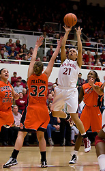 February 20, 2010; Stanford, CA, USA;  Stanford Cardinal guard Rosalyn Gold-Onwude (21) shoots over Oregon St. Beavers forward Kirsten Tilleman (32) during the first half at Maples Pavilion.  Stanford defeated Oregon State 82-48.
