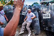 10 SEPTEMBER 2003 - CANCUN, QUINTANA ROO, MEXICO: South Korean farmers battle Mexican riot police during a protest against liberalizing agricultural trade at the WTO ministerial conference in Cancun. Tens of thousands of protesters, mostly farmers, came to Cancun for the fifth ministerial of the World Trade Organization (WTO). They were protesting against developed nations pushing to get access to agricultural markets in developing nations. The talks ultimately collapsed after no progress with no agreements reached between the participants.           PHOTO BY JACK KURTZ