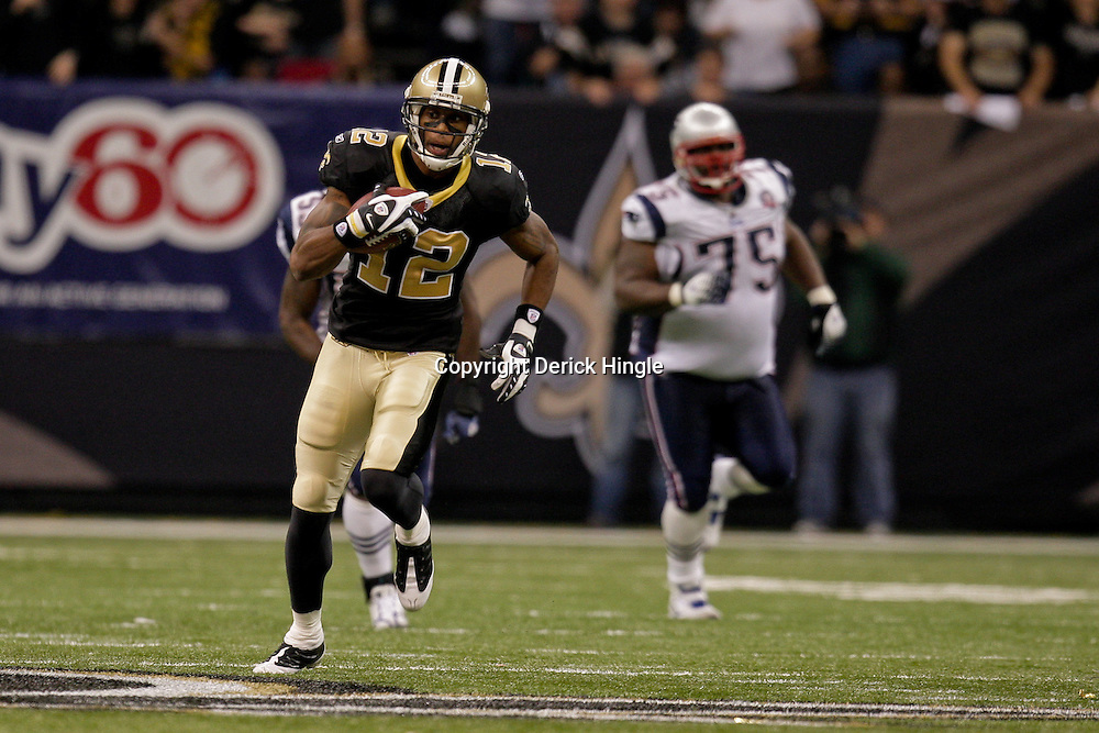2009 November 30: New Orleans Saints wide receiver Marques Colston (12) runs from New England Patriots defenders during a 38-17 win by the New Orleans Saints over the New England Patriots at the Louisiana Superdome in New Orleans, Louisiana.