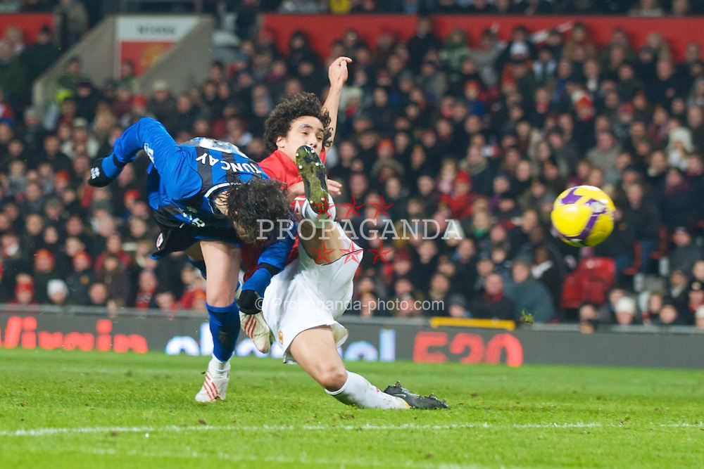 MANCHESTER, ENGLAND - Monday, December 29, 2008: Middlesbrough's Tuncay Sanli misses a header under pressure from Manchester United's Rafael da Silva during the Premiership match at Old Trafford. (Photo by David Rawcliffe/Propaganda)
