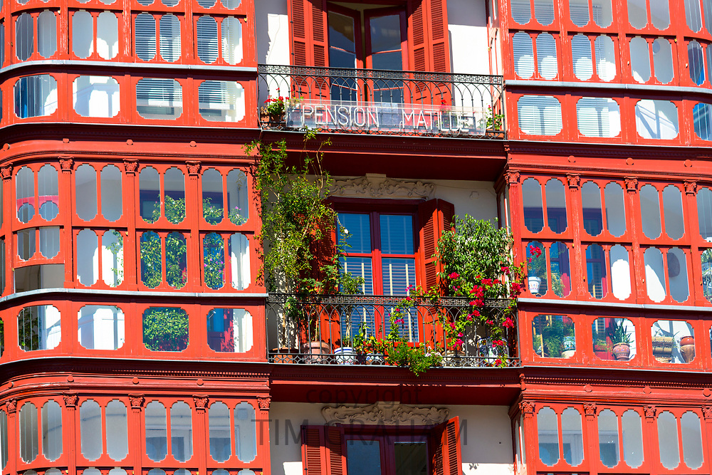 Pension Matilde hotel in Miguel Unamuno Plaza. Traditional glasshouses with glass-covered balconies in Bilbao, Spain