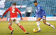 Gillingham forward Dominic Samuel takes on Barnsley Defender James Bree during the Sky Bet League 1 match between Gillingham and Barnsley at the MEMS Priestfield Stadium, Gillingham, England on 13 February 2016. Photo by Andy Walter.