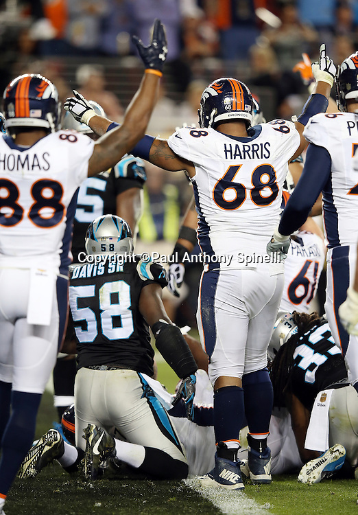 Denver Broncos tackle Ryan Harris (68) and Denver Broncos wide receiver Demaryius Thomas (88) raise their arms in celebration after Denver Broncos running back C.J. Anderson (22) runs for a 1 yard fourth quarter touchdown that leads to a 24-10 game clinching score late in the fourth quarter during the NFL Super Bowl 50 football game against the Carolina Panthers on Sunday, Feb. 7, 2016 in Santa Clara, Calif. The Broncos won the game 24-10. (©Paul Anthony Spinelli)