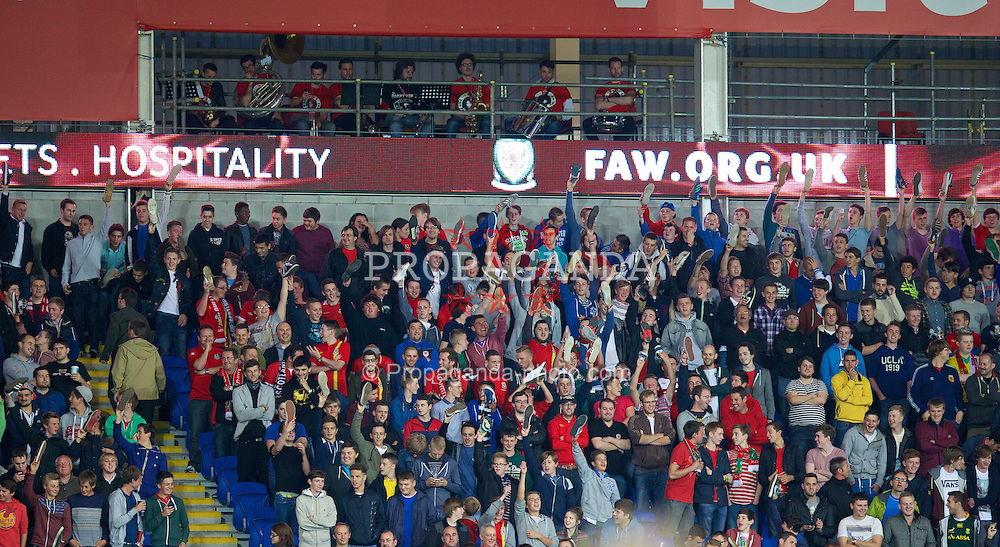 CARDIFF, WALES - Tuesday, September 10, 2013: Wales supporters hold their shoes up during the 2014 FIFA World Cup Brazil Qualifying Group A match against Serbia at the Cardiff CIty Stadium. (Pic by David Rawcliffe/Propaganda)