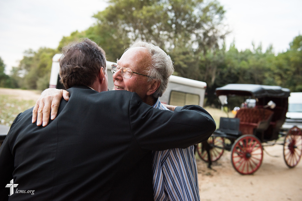 Director Dr. Ardon Albrecht hugs Actor Greg Thornton, performing the role of Lutheran missionary Nils J. Bakke, after the end of filming for 'The First Rosa' documentary on Thursday, September 25, 2014, near Selma, Ala.  LCMS Communications/Erik M. Lunsford