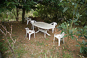 plastic garden furniture placed at a secluded spot in the garden