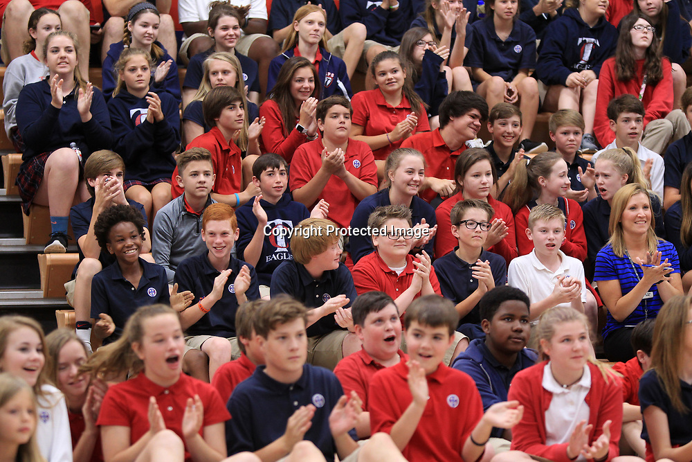 TCPS students applaud as Azie Leathers learns about her trip to Disney World this summer that was provided by TCPS on Wednesday morning.