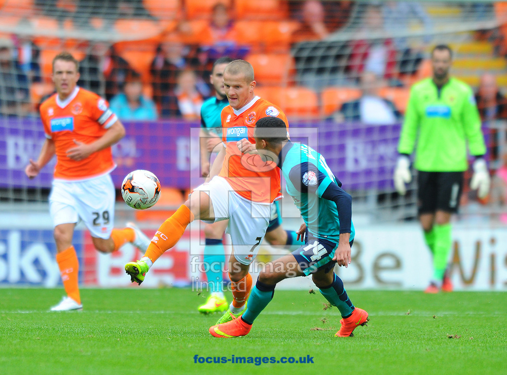 Tomasz Cywka of Blackpool (second right) goes ahead of Marcus Olsson of Blackburn Rovers (right) during the Sky Bet Championship match at Bloomfield Road, Blackpool<br /> Picture by Greg Kwasnik/Focus Images Ltd +44 7902 021456<br /> 16/08/2014