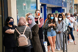 Edinburgh, Scotland, UK. 24 July, 2020. Social distancing in queue by customers wearing facemark outside Zara on Princes Street in Edinburgh. Iain Masterton/Alamy Live News