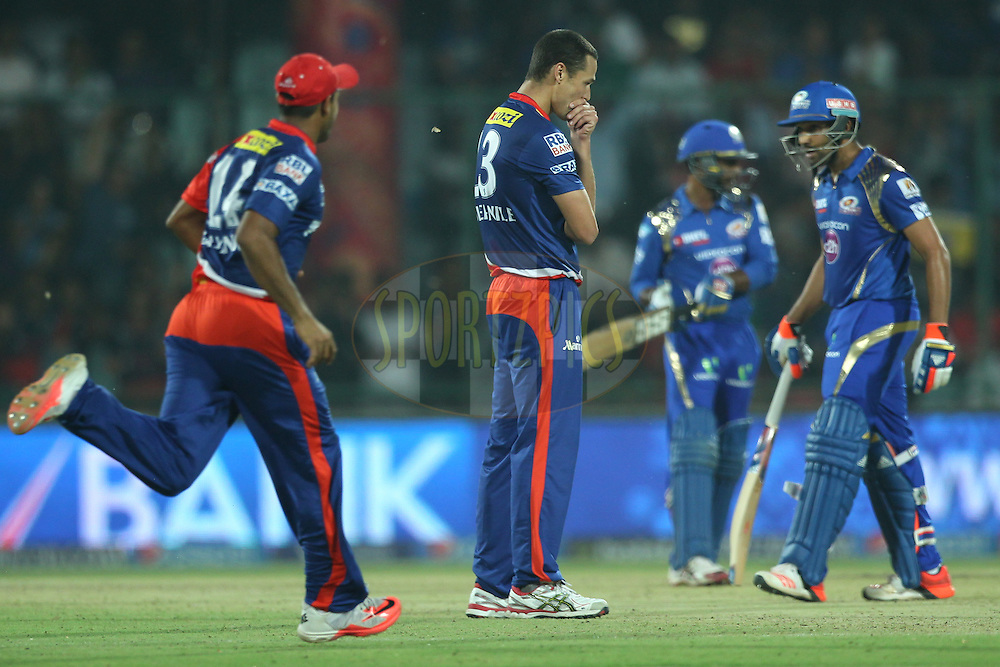 Nathan Coulter-Nile of the Delhi Daredevils take the wicket of Rohit Sharma captain of the Mumbai Indians during match 21 of the Pepsi IPL 2015 (Indian Premier League) between The Delhi Daredevils and The Mumbai Indians held at the Ferozeshah Kotla stadium in Delhi, India on the 23rd April 2015.<br /> <br /> Photo by:  Deepak Malik / SPORTZPICS / IPL