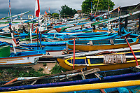 Colorful fishing boats lined up at the Kedonganan Fish Market in Bali, Indonesia.