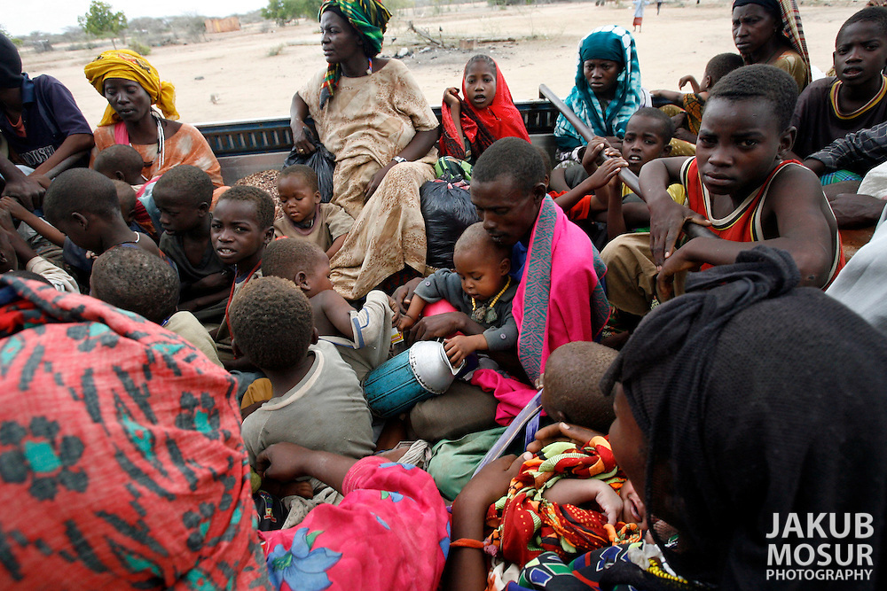 September 13, 2006 - Somali refugees sit aboard UNHCR trucks at Liboi, Kenya near the border with Somalia, before being transported to Dagahaley Refugee Camp in Dadaab. Somalis are fleeing from recent clashes between Islamic Courts and the Transitional Government of Somalia and the latest drought in the region. Over 21,000 refugees since January 2006 have arrived in Dadaab, in the North Eastern province of Kenya. Despite the recent influx of refugees, funding by the international community has been reduced, according to CARE International. (Photo by Jakub Mosur/Polaris)