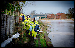 Burrowbridge, Somerset, United Kingdom.Sunday, 9th February 2014. Members of the emergency services help residents remove their items from their homes. The Somerset Levels  has been flooded since the start of 2014, with people being forced to leave their homes. Picture by Andrew Parsons / i-Images