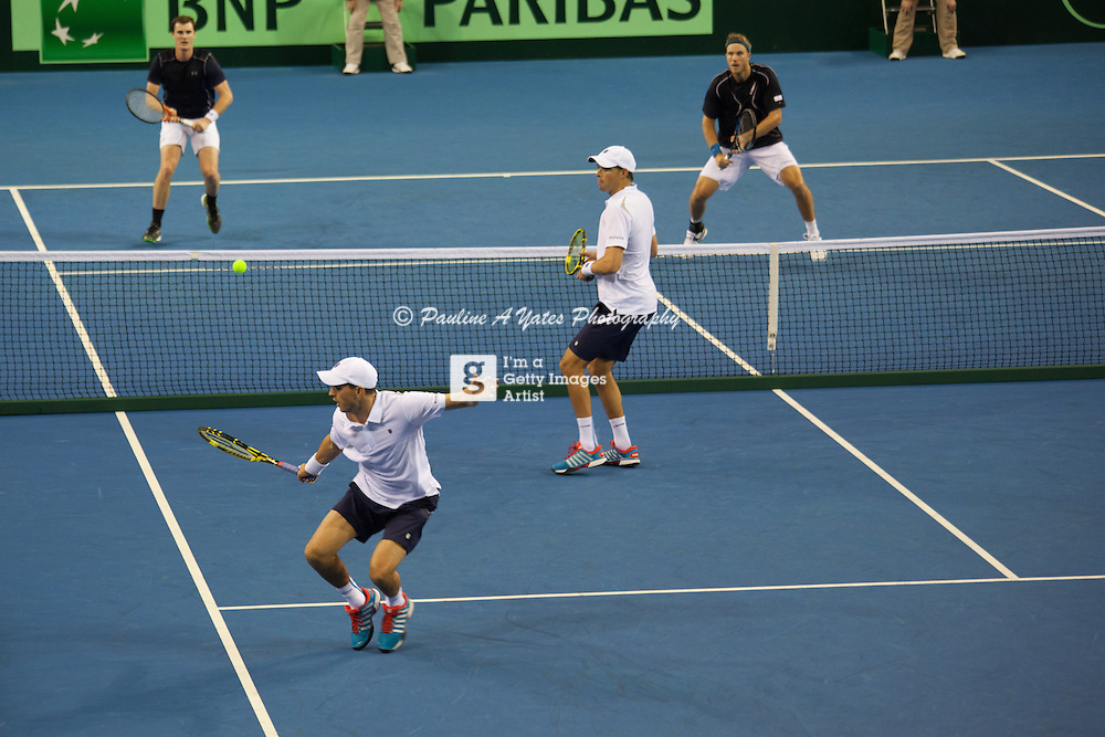 Dominic Inglot and Jamie Murray put the Bryan Brothers off balance as they try to return the ball.