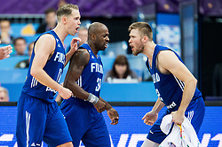 Petteri Koponen of Finland, Jamar Wilson of Finland and Matti Nuutinen of Finland celebrate during basketball match between National Teams of France and Finland at Day 1 of the FIBA EuroBasket 2017 at Hartwall Arena in Helsinki, Finland on August 31, 2017. Photo by Vid Ponikvar / Sportida
