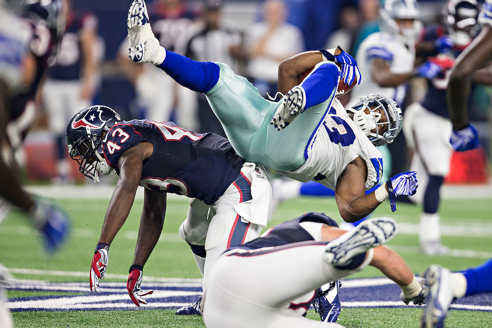 ARLINGTON, TX - SEPTEMBER 3:  Ben Malena #33 of the Dallas Cowboys is tackled during a preseason game by Corey Moore #43 of the Houston Texans at AT&T Stadium on September 3, 2015 in Arlington, Texas.  The Cowboys defeated the Texans 21-14.  (Photo by Wesley Hitt/Getty Images) *** Local Caption *** Ben Malena; Corey Moore