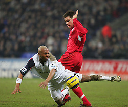 BOLTON, ENGLAND - MONDAY, JANUARY 2nd, 2006: Liverpool's Steve Finnan see Bolton Wanderers' El-Hadji Diouf go flying during the Premiership match at the Reebok Stadium. (Pic by David Rawcliffe/Propaganda)