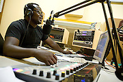 Radio host during a radio broadcast in studio. Northern Ghana, Thursday November 13, 2008.