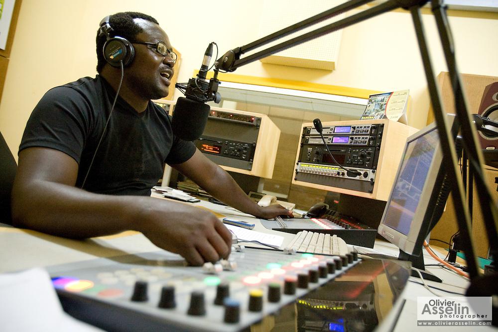 Radio host during a radio broadcast in studio. Northern Ghana, Thursday November 13, 2008.