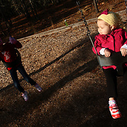 Holly Larue Frizzelle, 2, swings at a birthday party in January 2013. The party was the first contact with children Larue had in more than a month due to her compromised immune system. On December 27, 2012 two year old Holly Larue Frizzelle was diagnosed with Acute Lymphoblastic Leukemia. What began as a stomach ache and visit to her regular pediatrician led to a hospital admission, transport to the University of North Carolina Children's Hospital, and more than two years of treatment.