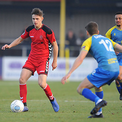 TELFORD COPYRIGHT MIKE SHERIDAN 23/2/2019 - Ryan Barnett of AFC Telford (on loan from Shrewsbury Town Football Club) takes on George Carline during the FA Trophy quarter final fixture between Solihull Moors and AFC Telford United at the Automated Technology Group Stadium