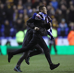 Reading fans invade the pitch at full time - Photo mandatory by-line: Robbie Stephenson/JMP - Mobile: 07966 386802 - 16/03/2015 - SPORT - Football - Reading - Madejski Stadium - Reading v Bradford City - FA Cup - Quarter Final - Replay
