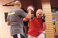 Gil Martinez (left) and Randy Couture do some focus mitt work during a training session ahead of UFC 105 at Straight Blast Gym in Manchester, England on November 11, 2009.