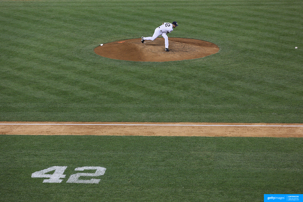 Mariano Rivera, the New York Yankees closer, pitching during his last game at Yankee Stadium before his retirement during the New York Yankees V Tampa Bay Rays, American League baseball game at Yankee Stadium. Mariano Rivera is the last Major League player still wearing Jackie Robinson's No. 42. and holds the record for the number of saves in Major League Baseball. Yankee Stadium, The Bronx, New York USA. 26th September 2013. Photo Tim Clayton