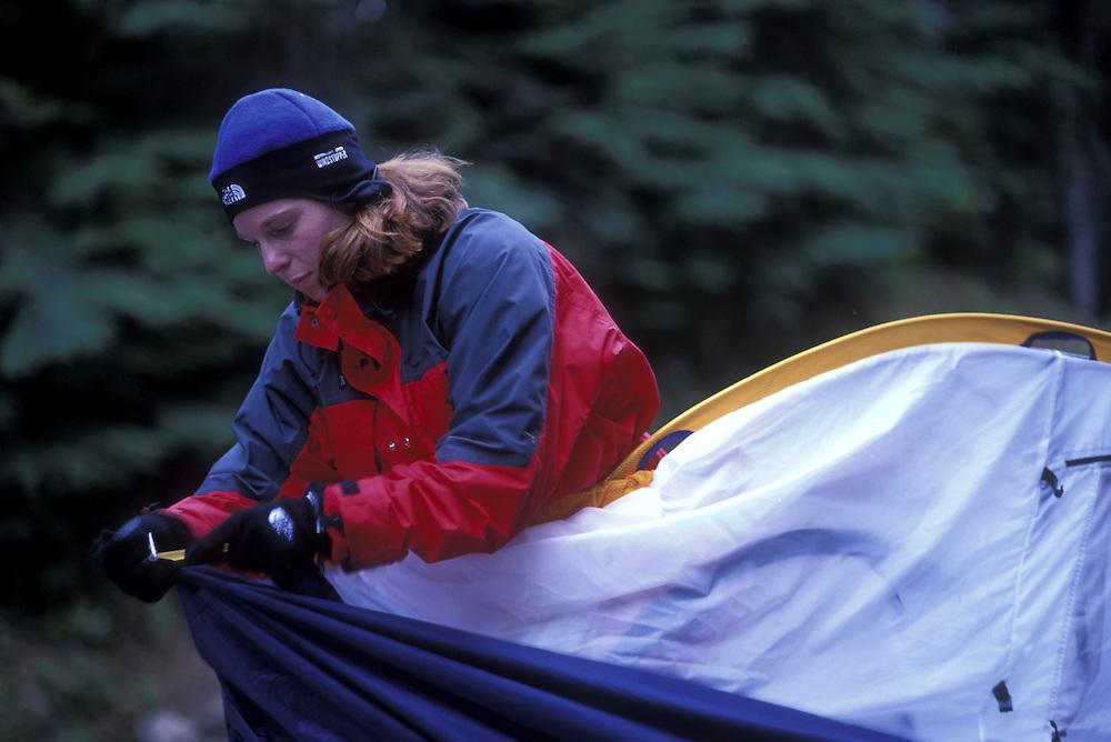 USA, Washington, (MR) Abby Dorman camps in rainforest in Cascade Range near Snoqualmie Pass