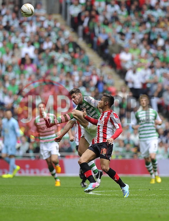 Yeovil Town's Joe Edwards battles for the high ball with Brentford's Harry Forrester - Photo mandatory by-line: Joe Meredith/JMP - Tel: Mobile: 07966 386802 19/05/2013 - SPORT - FOOTBALL - LEAGUE 1 - PLAY OFF - FINAL - Wembley Stadium - London - Brentford V Yeovil Town
