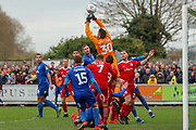 Accrington Stanley goalkeeper Dimitar Evtimov (30) fumbling cross during the EFL Sky Bet League 1 match between AFC Wimbledon and Accrington Stanley at the Cherry Red Records Stadium, Kingston, England on 6 April 2019.