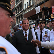 Police negotiators talk with organizers during the Occupy protesters march down Broadway, New York, on their way to Wall street during the Occupy May Day 2012 action day.  New York, USA. 1st May 2012. Photo Tim Clayton