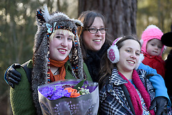 © Licensed to London News Pictures. 30/01/2016. Slough, UK. Sara Adams with daughters Caroline Adams, 23 and Daisy Adams, 12 at the formal opening of a wooden treehouse in memory of murder victim Alice Adams in Black Park, Wexham on Saturday 30th January. The 20-year-old was stabbed to death in August 2011 with her friend and co-worker Tibor Vass, at a staff flat behind the Radisson Edwardian Hotel near Heathrow Airport. The murderer was Attila Ban, aged 32,  who also worked at the hotel as a receptionist. After the death of Alice, her family created a charity called, Alice Adams Foundation, to raise money to build the treehouse. Photo credit should read: Emma Sheppard/LNP