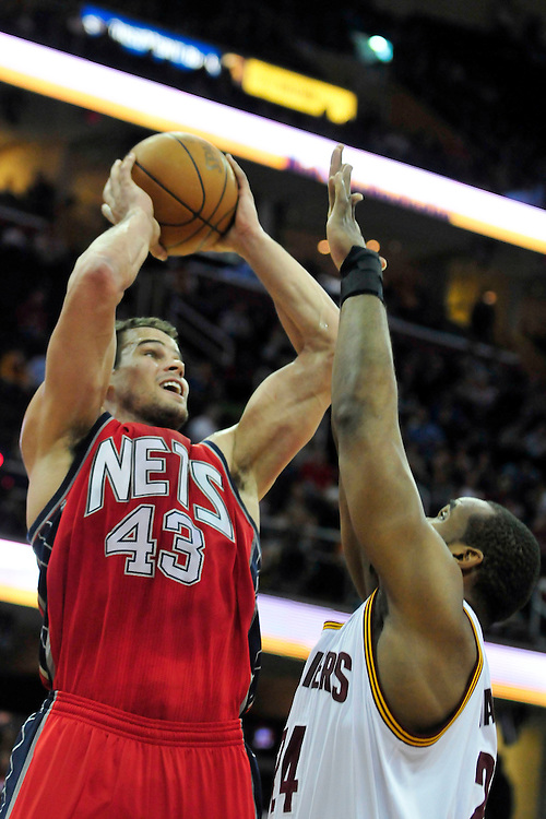 March 23, 2010; Cleveland, OH, USA; New Jersey Nets power forward Kris Humphries (43) shoots over Cleveland Cavaliers power forward Samardo Samuels (24) during the first quarter at Quicken Loans Arena. Mandatory Credit: Jason Miller-US PRESSWIRE
