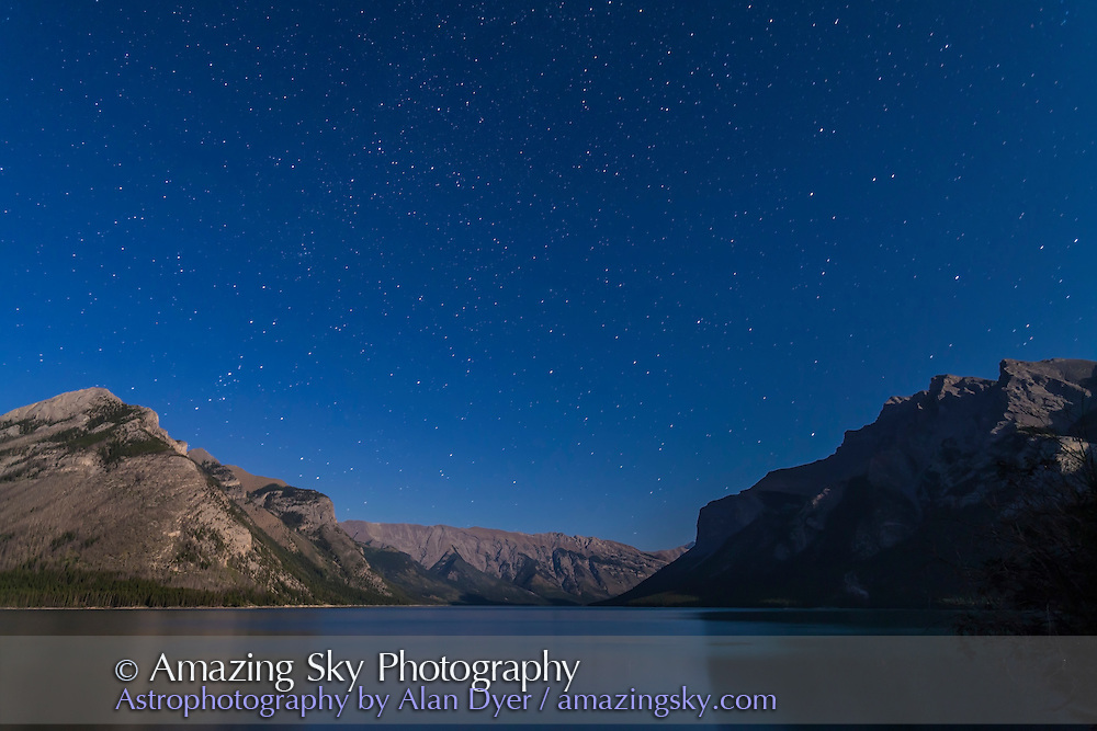 The northern autumn constellations of Andromeda, Cassiopeia, Perseus and Pegasus rising over Lake Minnewanka in Banff National Park, Alberta. Taken July 29, 2012 with Canon 5D MkII and 16-35mm lens for 40s at f/4 and ISO 800. Moonlight from waxing gibbous Moon (off camera) provides the illumination.