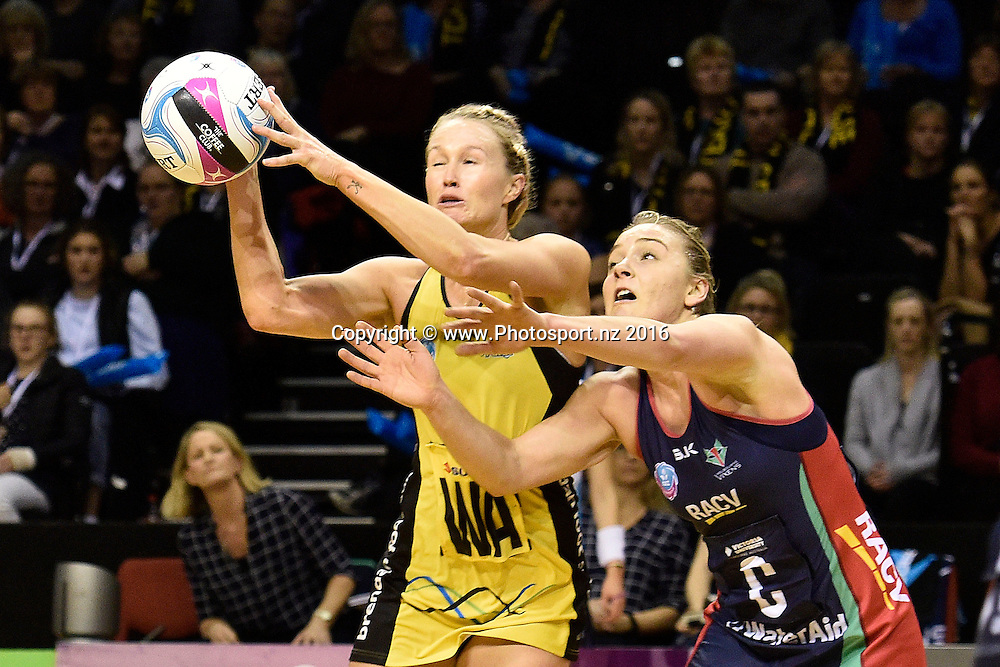 Pulse's Chelsea Locke (L) takes a pass with Vixen's Liz Watson during the ANZ Champs Pulse vs Vixens netball match at TSB Arena in Wellington on Monday the 04 July 2016. Copyright Photo by Marty Melville / www.Photosport.nz