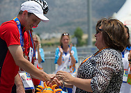 (L) athlete Jacek Cieslik of SO Poland & (R) Anna Komorowska - First Lady of Poland while medal ceremony after cycling competition during 2011 Special Olympics World Summer Games Athens on June 27, 2011..The idea of Special Olympics is that, with appropriate motivation and guidance, each person with intellectual disabilities can train, enjoy and benefit from participation in individual and team competitions...Greece, Athens, June 27, 2011...Picture also available in RAW (NEF) or TIFF format on special request...For editorial use only. Any commercial or promotional use requires permission...Mandatory credit: Photo by © Adam Nurkiewicz / Mediasport