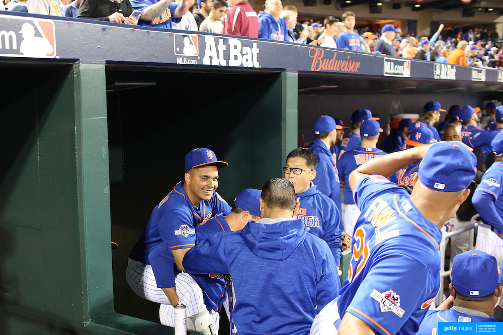 Ruben Tejada, New York Mets, with his broken leg is given a lift up to the dugout by team mate Kelly Johnson before the New York Mets Vs Los Angeles Dodgers, game three of the NL Division Series at Citi Field, Queens, New York. USA. 12th October 2015. Photo Tim Clayton for The Players Tribune