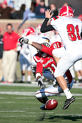 06 November 2010:  after a fumbled snap Marcus King is able to block a punt attempt by Nick Liste during a game between the Penguins of Youngstown State and the Redbirds of Illinois State at Hancock Stadium on the campus of Illinois State University in Normal Illinois.