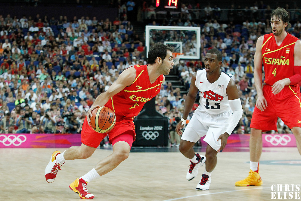 12 August 2012: Spain Jose Calderon drives past USA Chris Paul during 107-100 Team USA victory over Team Spain, during the men's Gold Medal Game, at the North Greenwich Arena, in London, Great Britain.
