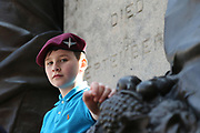 A young lad wears his dads beret before the demonstration in support of Soldier F by former service personnel in Central Manchester on 19 April 2019.