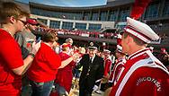 Michael Leckrone, director of the UW Marching Band, high fives fans at Badger Bash at Union South in 2014.